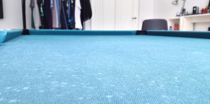 What Are The Small White Spots On My Pool Table Cloth?